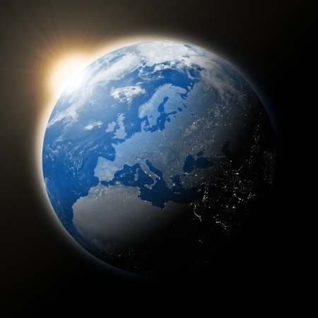 globe earth: Sun over Europe on blue planet Earth isolated on black background. Elements of this image furnished by NASA. Stock Photo