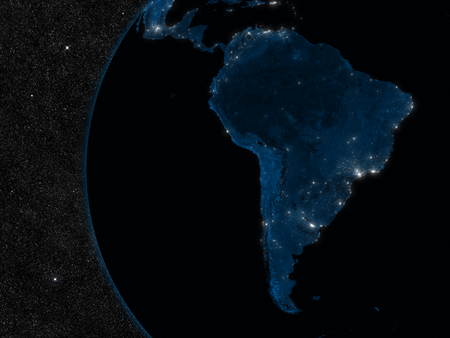 Night in South America with city lights viewed from space photo