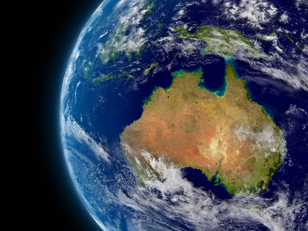 Australia viewed from space with atmosphere and clouds. photo
