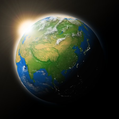 southeast: Sun over Southeast Asia on blue planet Earth isolated on black. Highly detailed planet surface.