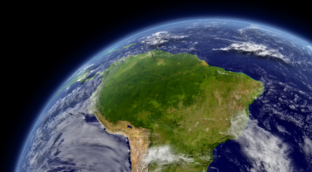 South America viewed from space with atmosphere and clouds.  photo