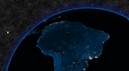 Night in South America with city lights viewed from space.  photo