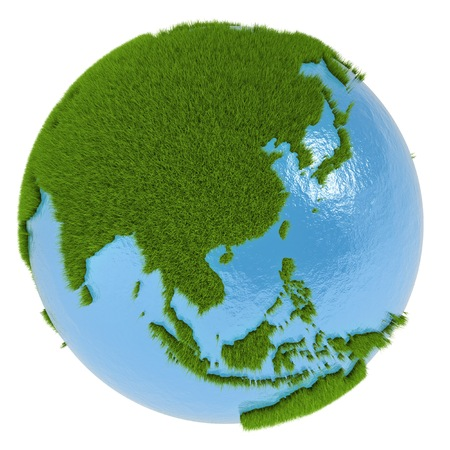 clean environment: East Asia on green planet covered with grass isolated on white. Concept of ecology and clean environment.