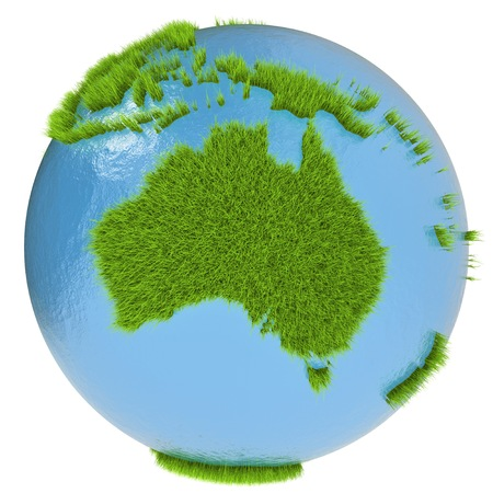 clean environment: Australia continent on green planet covered with grass isolated on white. Concept of ecology and clean environment.