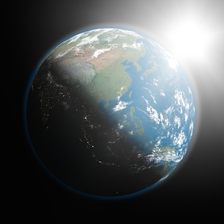 southeast: Space view of the sun rising over southeast Asia on planet Earth. Elements of this image furnished by NASA.