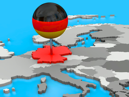Red Germany pinned to the map of Europe with a big push pin coloured as the German flag photo