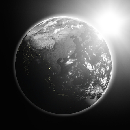 southeast: Space view of the sun rising over southeast Asia on black planet Earth.  Stock Photo