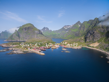 fishing huts: Aerial view of scenic fishing village A on Lofoten islands in Norway with traditional red fishing huts