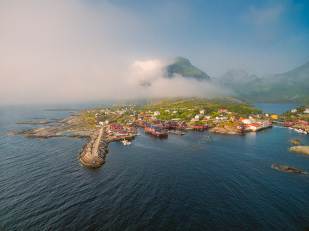 fishing huts: Scenic aerial view of fishing village A on Lofoten islands in Norway with traditional red fishing huts