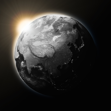 southeast asia: Sun over Southeast Asia on dark planet Earth isolated on black background. Highly detailed planet surface. Stock Photo