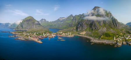 fishing huts: Aerial panorama of scenic fishing village A on Lofoten islands in Norway with traditional red fishing huts