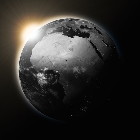 rise: Sun over Africa on dark planet Earth isolated on black background. Highly detailed planet surface. Elements of this image furnished by NASA. Stock Photo