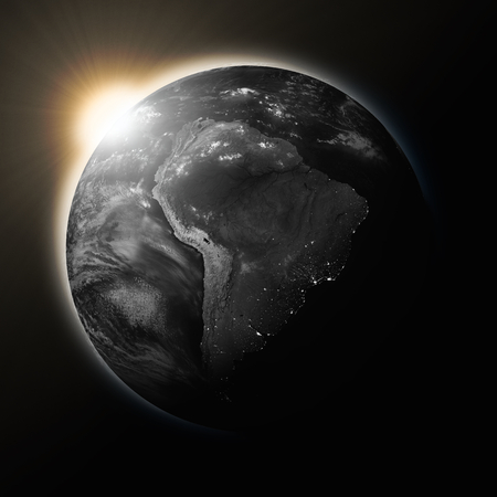 latin: Sun over South America on dark planet Earth isolated on black background. Highly detailed planet surface.  Stock Photo
