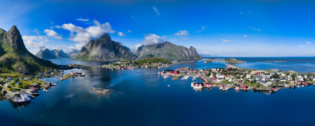 panorama: Breathtaking aerial panorama of fishing town Reine and surrounding fjords on Lofoten islands in Norway, famous tourist destination