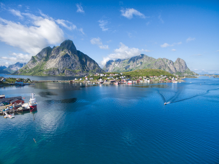 destination scenic: Scenic aerial view of fishing town Reine on Lofoten islands in Norway, famous tourist destination