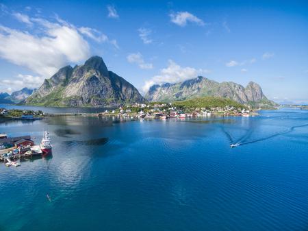tourist destination: Scenic aerial view of fishing town Reine on Lofoten islands in Norway, famous tourist destination