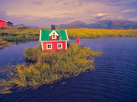 islet: Romantic miniature scandinavian red house on tiny islet
