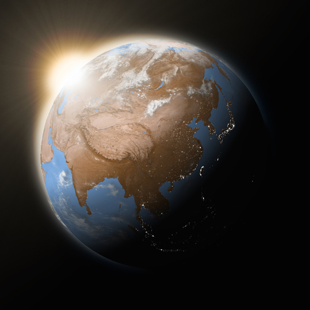 himalayas: Sun over Southeast Asia on blue planet Earth isolated on black background.