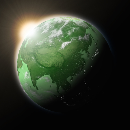 southeast asia: Sun over Southeast Asia on green planet Earth isolated on black background. Highly detailed planet surface.
