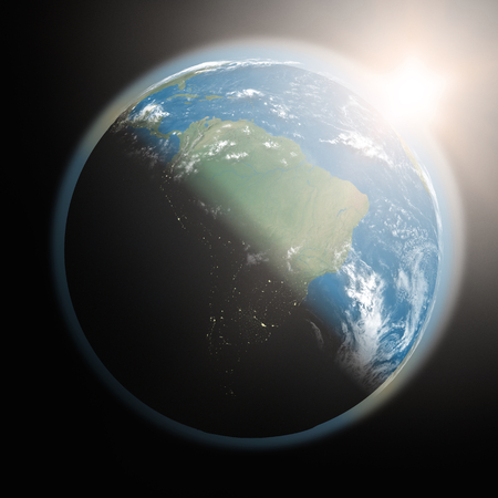 sun rising: Space view of the sun rising over South America on planet Earth. Elements of this image furnished by NASA.