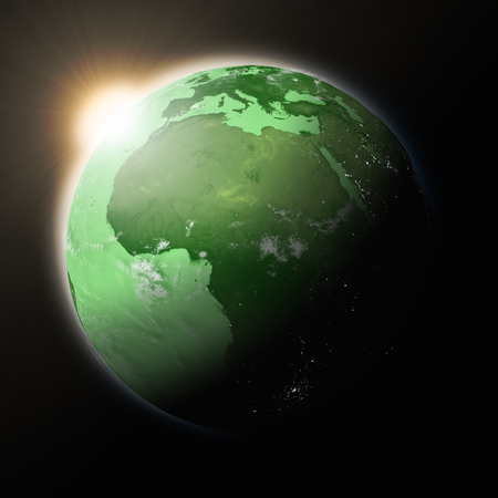 green planet: Sun over Africa on green planet Earth isolated on black background. Highly detailed planet surface. Elements of this image furnished by NASA.