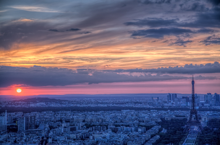 Eiffel Tower: Scenic aerial view of sunset over Paris with dark Eiffel Tower