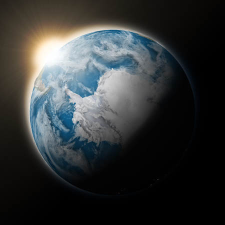 climate: Sun over Antarctica on blue planet Earth isolated on black background. Highly detailed planet surface. Elements of this image furnished by NASA.