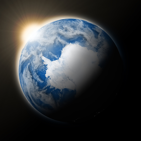 background antarctica: Sun over Antarctica on blue planet Earth isolated on black background. Highly detailed planet surface.