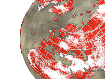 brick earth: Europe on brick wall model of planet Earth with continents made of red bricks and oceans of wet concrete. 3D rendering. Stock Photo