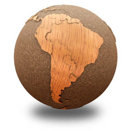 South America on 3D model of wooden planet Earth with oceans made of cork and wooden continents with embossed countries. 3D illustration isolated on white background with shadow. Stock Photo
