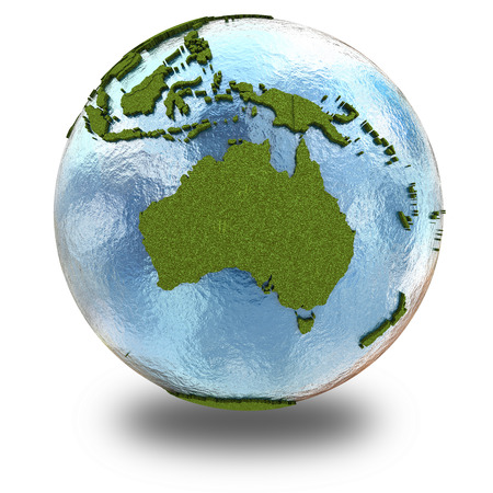 grassy: Australia on 3D model of planet Earth with grassy continents with embossed countries and blue ocean. 3D illustration isolated on white background with shadow.