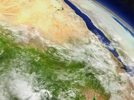 Sudan and South Sudan with surrounding region as seen from Earths orbit in space. 3D illustration with highly detailed realistic planet surface and clouds in the atmosphere. Banco de Imagens