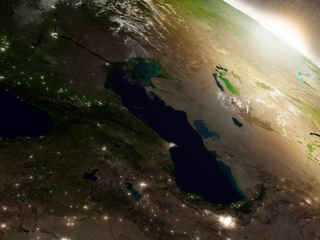 city lights: Caucasus region during sunrise with surrounding region during sunrise as seen from Earths orbit in space. 3D illustration with highly detailed realistic planet surface, clouds and city lights. Stock Photo