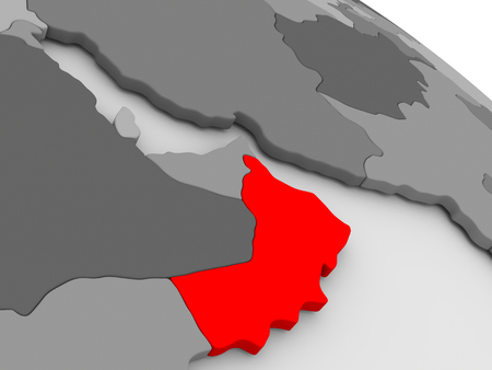 highlighted: Oman highlighted in red on model of globe. 3D illustration Stock Photo