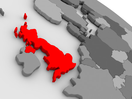 United Kingdom highlighted in red on model of globe. 3D illustration