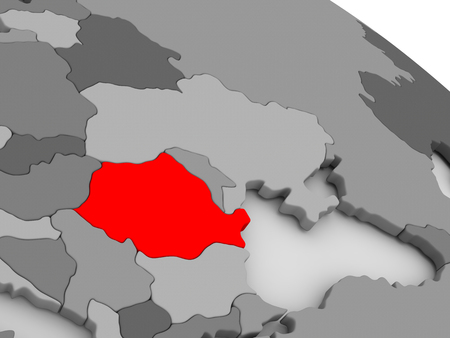 highlighted: Romania highlighted in red on model of globe. 3D illustration