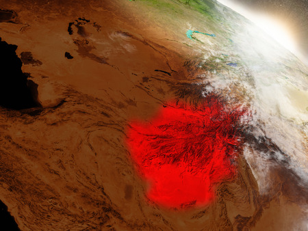 an orbit: Afghanistan highlighted in red as seen from Earths orbit in space. 3D illustration with highly detailed planet surface. Stock Photo