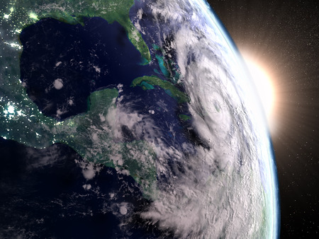 catastrophic: Hurricane Matthew from space approaching Florida in America during sunrise. 3D illustration. Elements of this image furnished by NASA Stock Photo