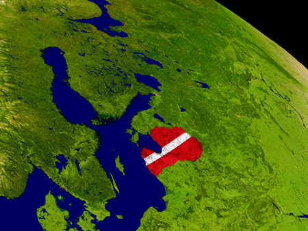 Map of Latvia with embedded flag on planet surface. 3D illustration. Stock Photo