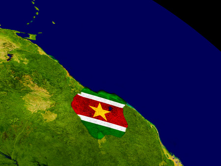 embedded: Map of Suriname with embedded flag on planet surface. 3D illustration.