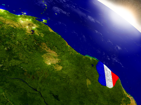 visible: French Guiana with embedded flag on planet surface during sunrise. 3D illustration with highly detailed realistic planet surface and visible city lights.