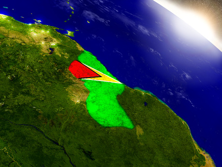 Guyana with embedded flag on planet surface during sunrise. 3D illustration with highly detailed realistic planet surface and visible city lights. Elements of this image furnished by NASA.