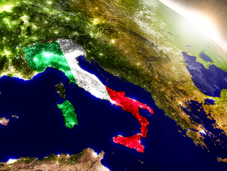 visible: Italy with embedded flag on planet surface during sunrise. 3D illustration with highly detailed realistic planet surface and visible city lights. Stock Photo