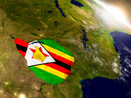 Zimbabwe with embedded flag on planet surface during sunrise. 3D illustration with highly detailed realistic planet surface and visible city lights. Stock Photo