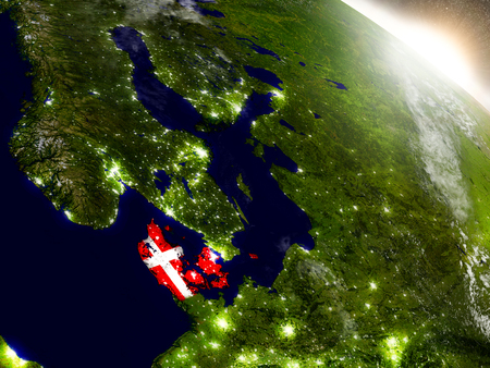 Denmark with embedded flag on planet surface during sunrise. 3D illustration with highly detailed realistic planet surface and visible city lights.