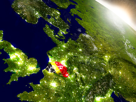 belgie: Belgium with embedded flag on planet surface during sunrise. 3D illustration with highly detailed realistic planet surface and visible city lights.