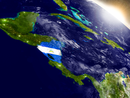 detailed image: Nicaragua with embedded flag on planet surface during sunrise. 3D illustration with highly detailed realistic planet surface and visible city lights. Elements of this image furnished by NASA. Stock Photo