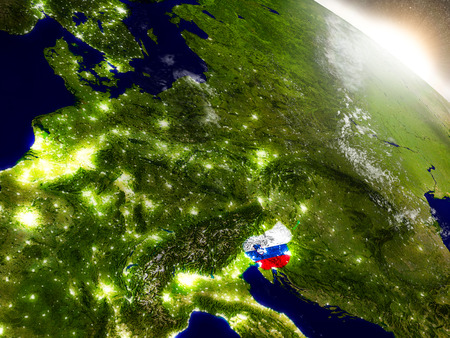 Slovenia with embedded flag on planet surface during sunrise. 3D illustration with highly detailed realistic planet surface and visible city lights.