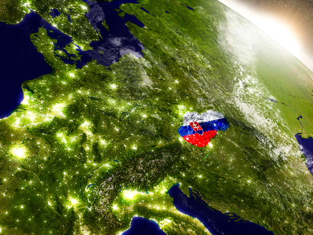 visible: Slovakia with embedded flag on planet surface during sunrise. 3D illustration with highly detailed realistic planet surface and visible city lights.