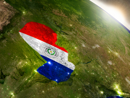 visible: Paraguay with embedded flag on planet surface during sunrise. 3D illustration with highly detailed realistic planet surface and visible city lights.